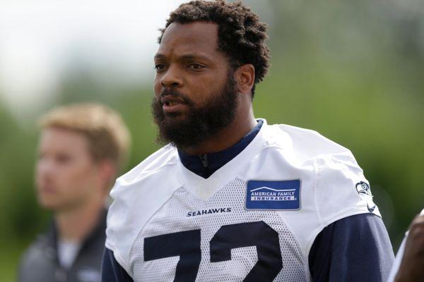 Seahawks' Michael Bennett Sits Out National Anthem After Charlotteville Protests Turn Violent
